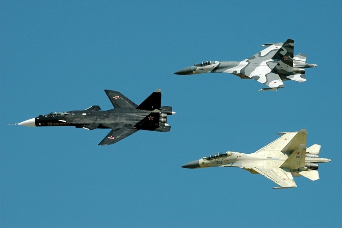The SU-47, flying with the rest of Sukhoi fighters,