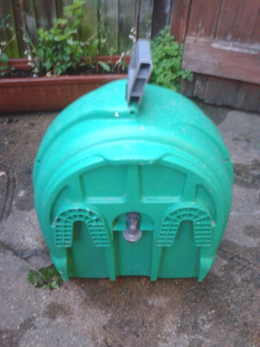 The back of the Hozelock hose reel, showing the slots which slide onto the wall mountings (not shown)