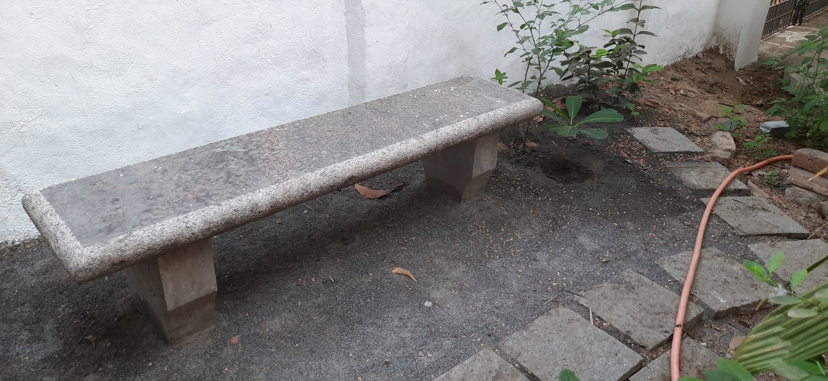 Garden bench made of unfinished granite