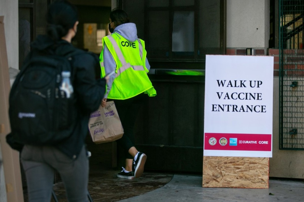 Individuals show up this week at another immunization site at USC intended to make portions accessible to hard-hit networks and those without a car.