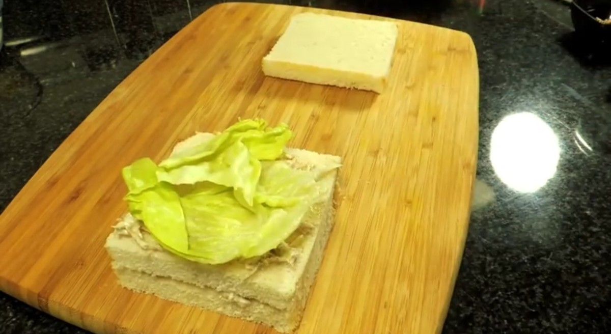 Put lettuce on another slice