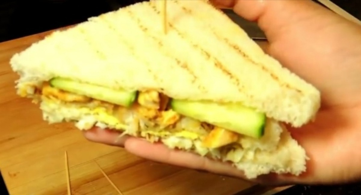 A chicken club sandwich is ready to eat