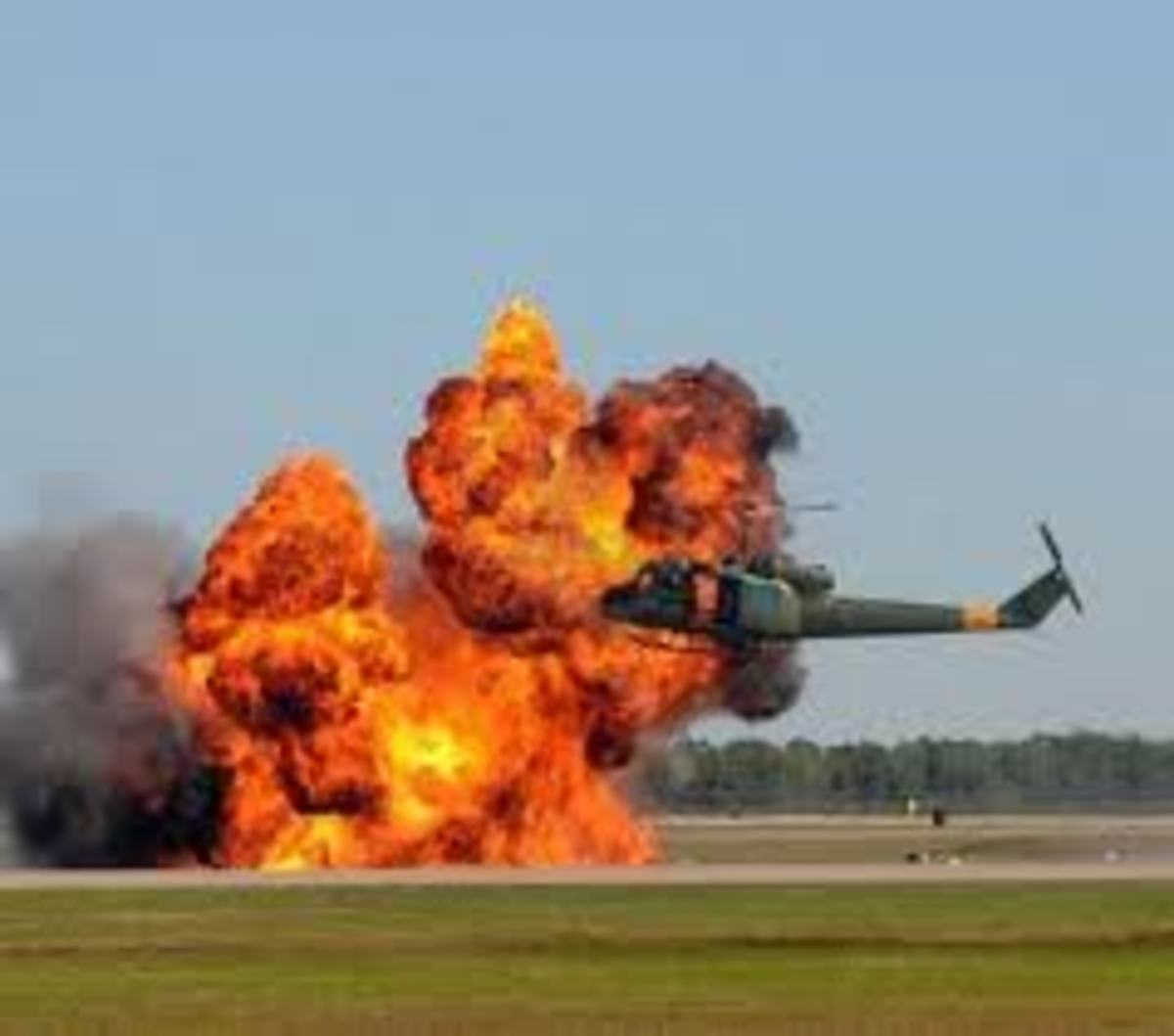 Helicopter hovering near a giant explosion