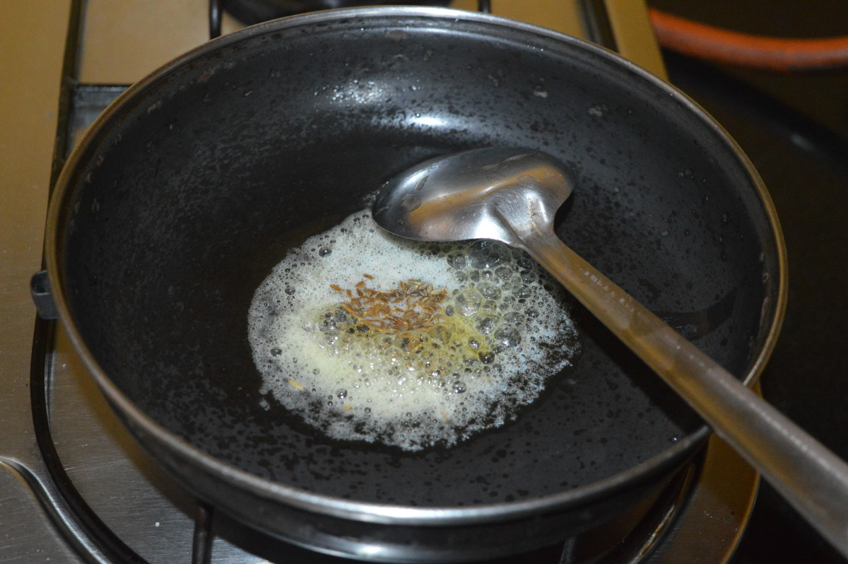 Add cumin seeds. Allow them to crackle.