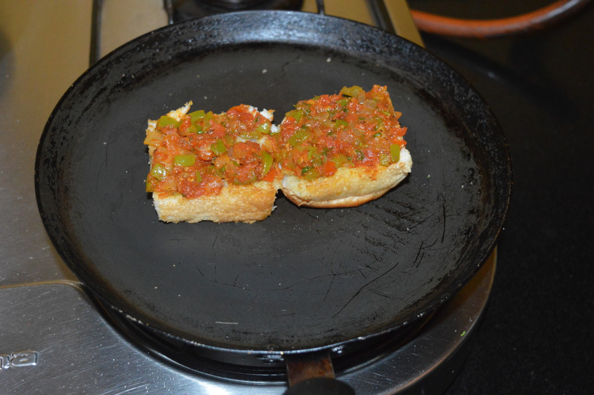 Step five: Start making masala pav. Heat a pan and add butter. Cut a pav bun horizontally in the middle and place it on the pan. Toast it lightly on both sides.