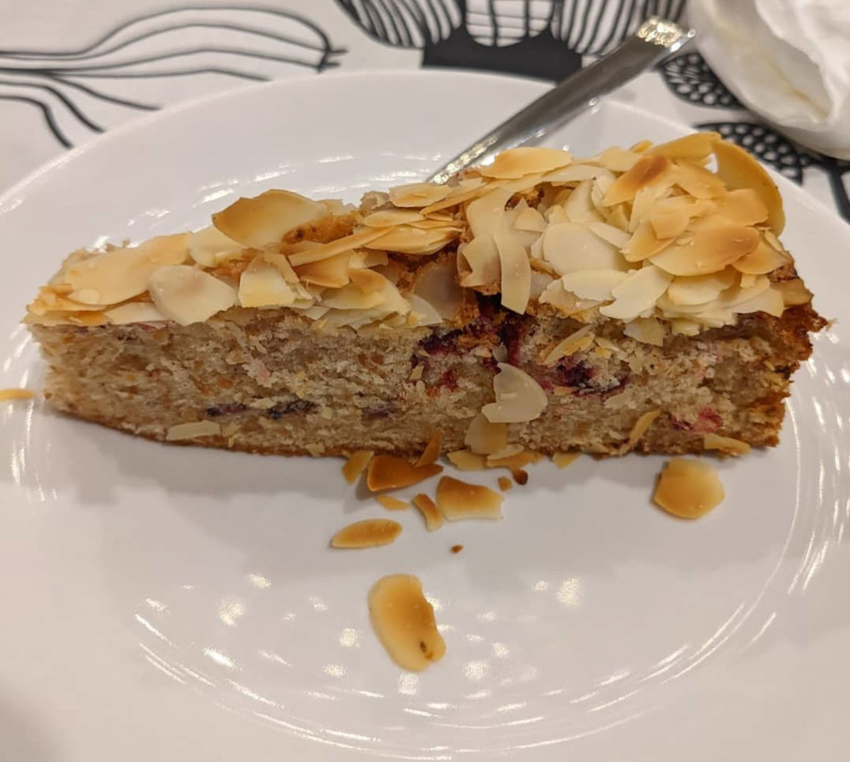 Slice of brown butter almond cake with freeze-dried plum slices and Davidson plum powder