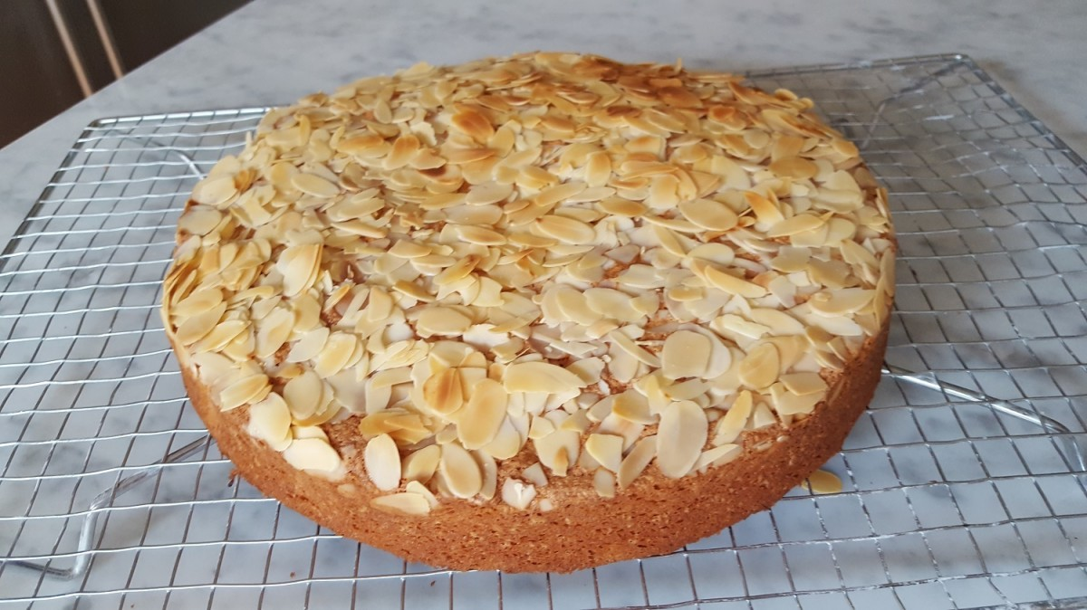 Brown butter almond cake cooling on rack