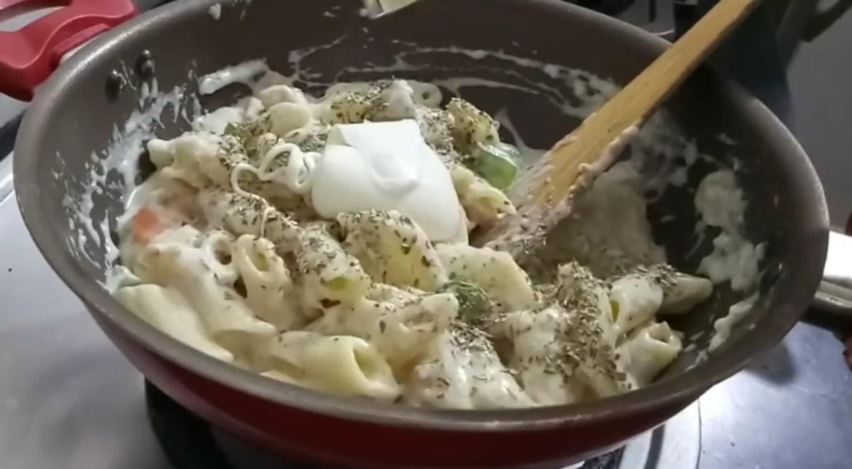 Add oregano and mozzarella cheese