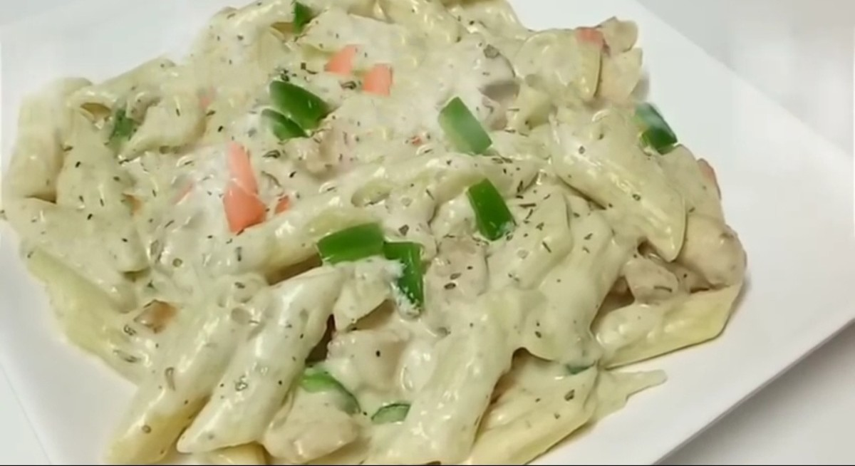Creamy and cheesy white pasta is ready to eat