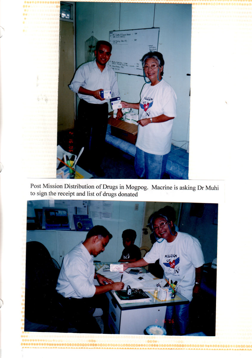 Macrine and I distributing drugs in Mogpog, Marinduque. 2006