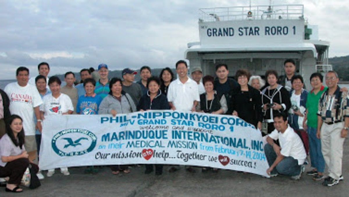 Macrine and I welcoming medical missioners from US and Canada from ferry boat from Manila to Marinduque, 2011
