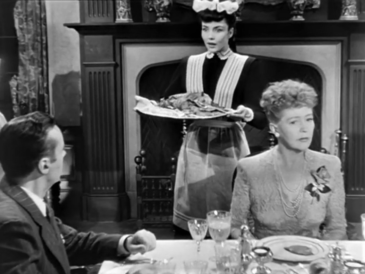 "Charles Boyer, Jennifer Jones, Margaret Bannerman.  In this scene Cluny will drop the tray and yell, ""Nuts to the Squirrels"""