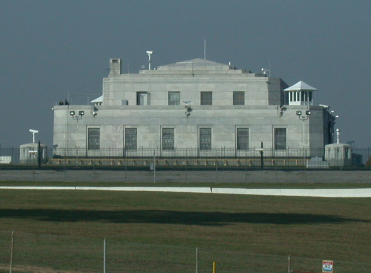 The United States Bullion Depository in Kentucky. Notice the cameras, wire fences, and guard towers.