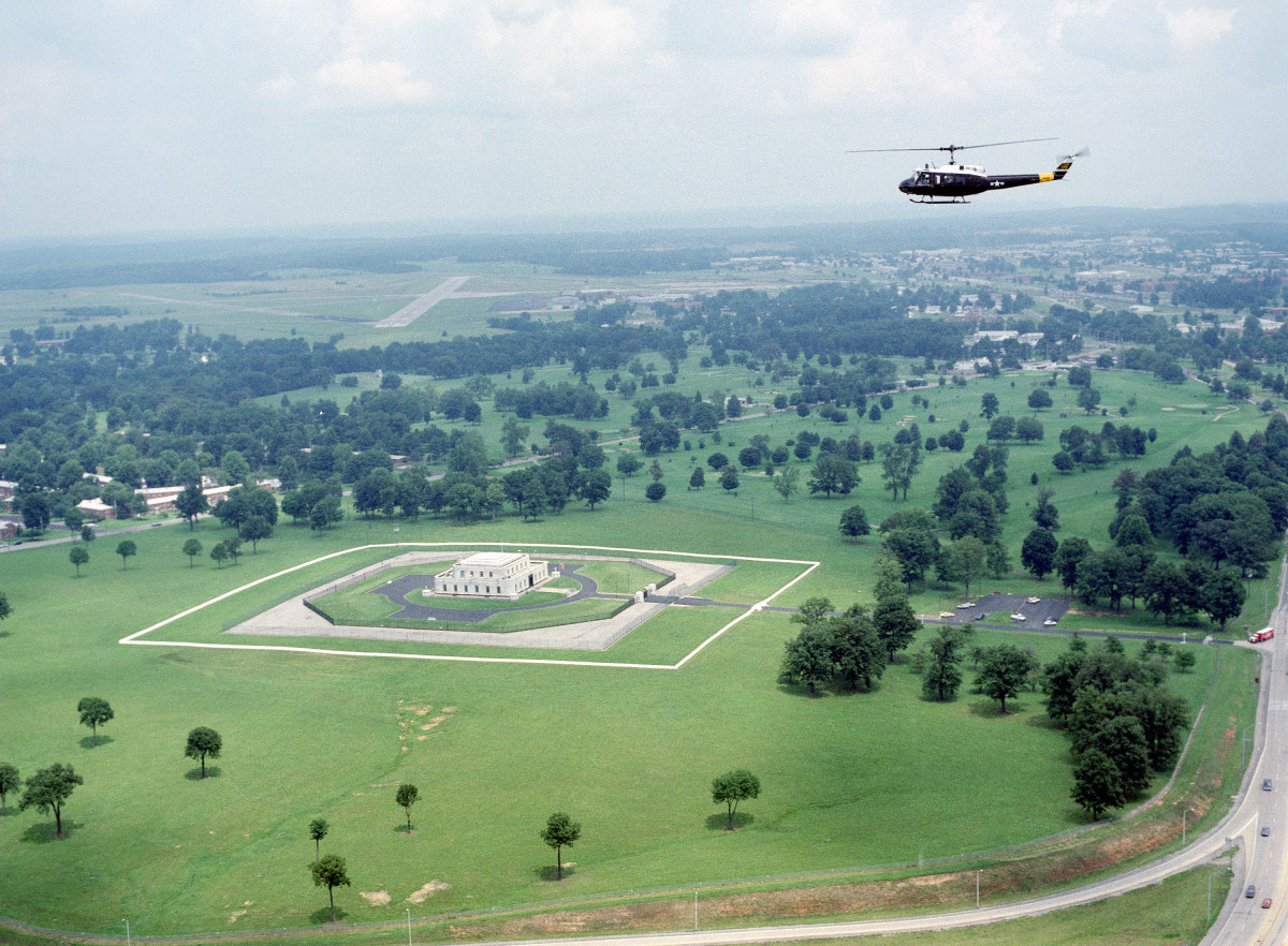 An UH-1 Iroquois helicopter flies over the US Gold Bullion Depository.