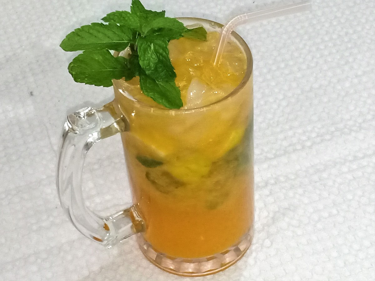 Refreshing mojito mocktail prepared with mandarin oranges
