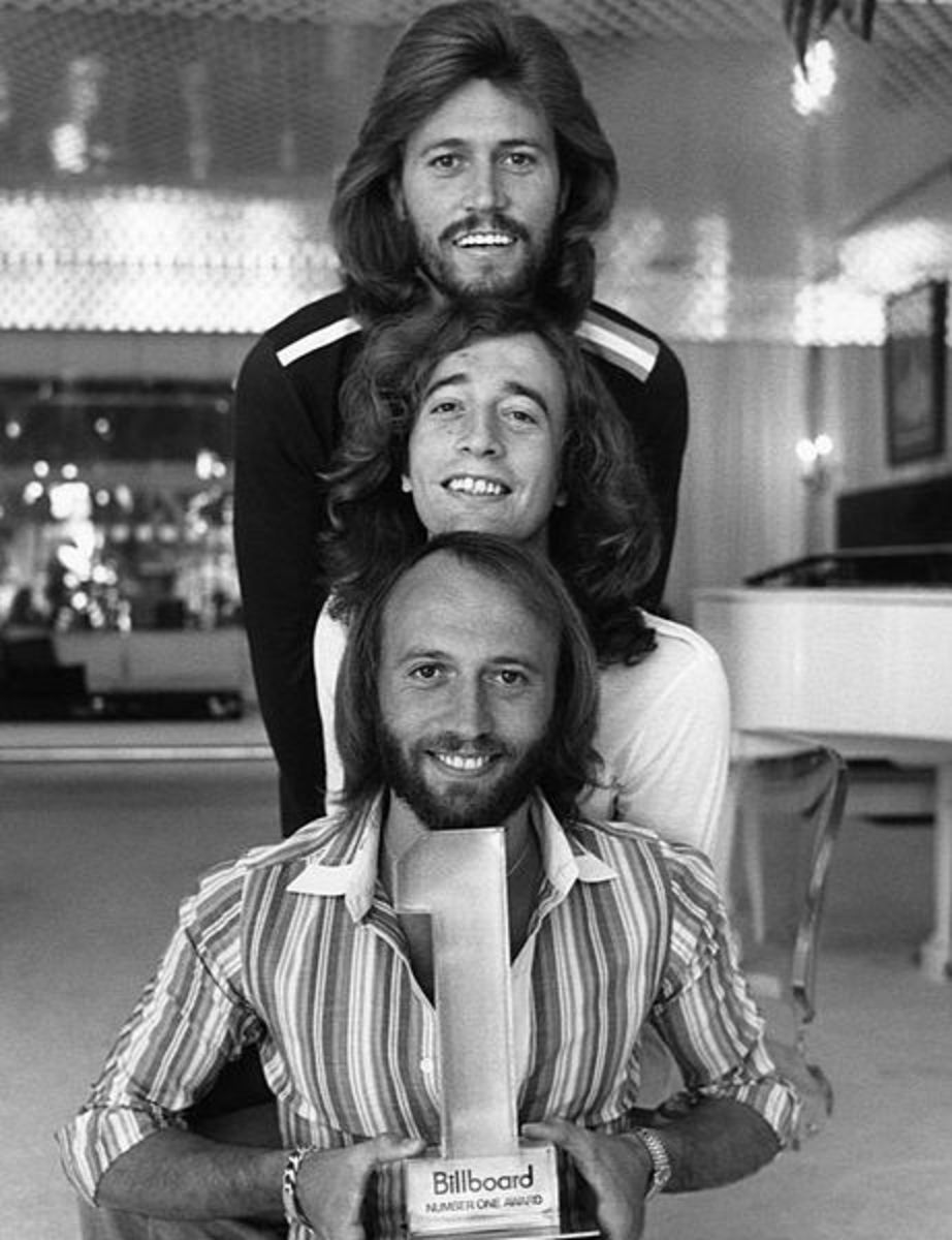 This NBC Television publicity photograph of the Bee Gees (Barry, Robin, and Maurice Gibb) was taken on November 18, 1977 for the television special Billboard #1 Music Awards.