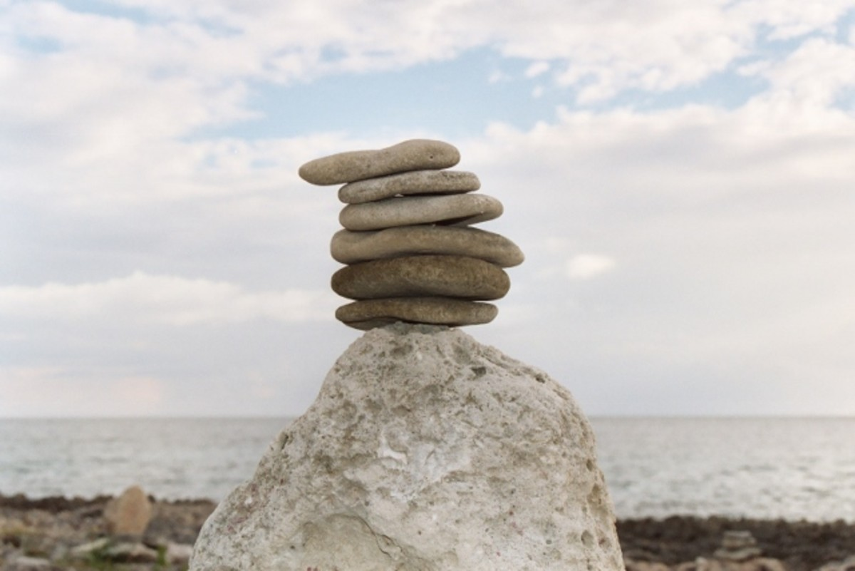 """Stone balancing is a popular art. These balanced stones were photograped by the author at the spa resort, """"Jackie's on the Reef,"""" in Negril, Jamaica, West Indies."""