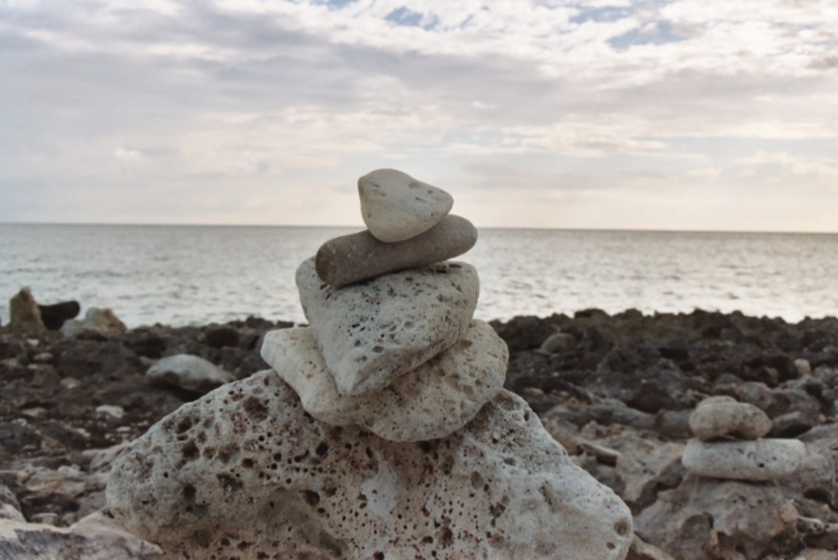 The stones represent a peace and balance that we strive for within ourselves.