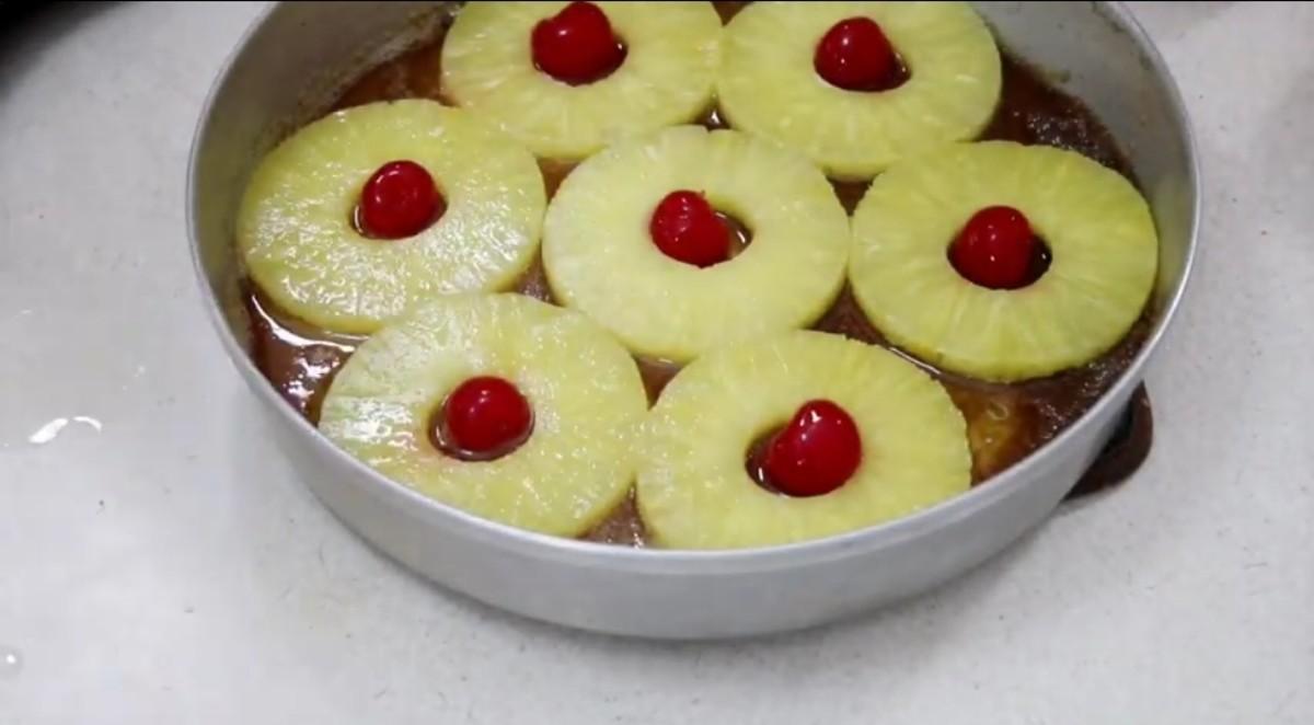 Arrange pineapple rings and cherry