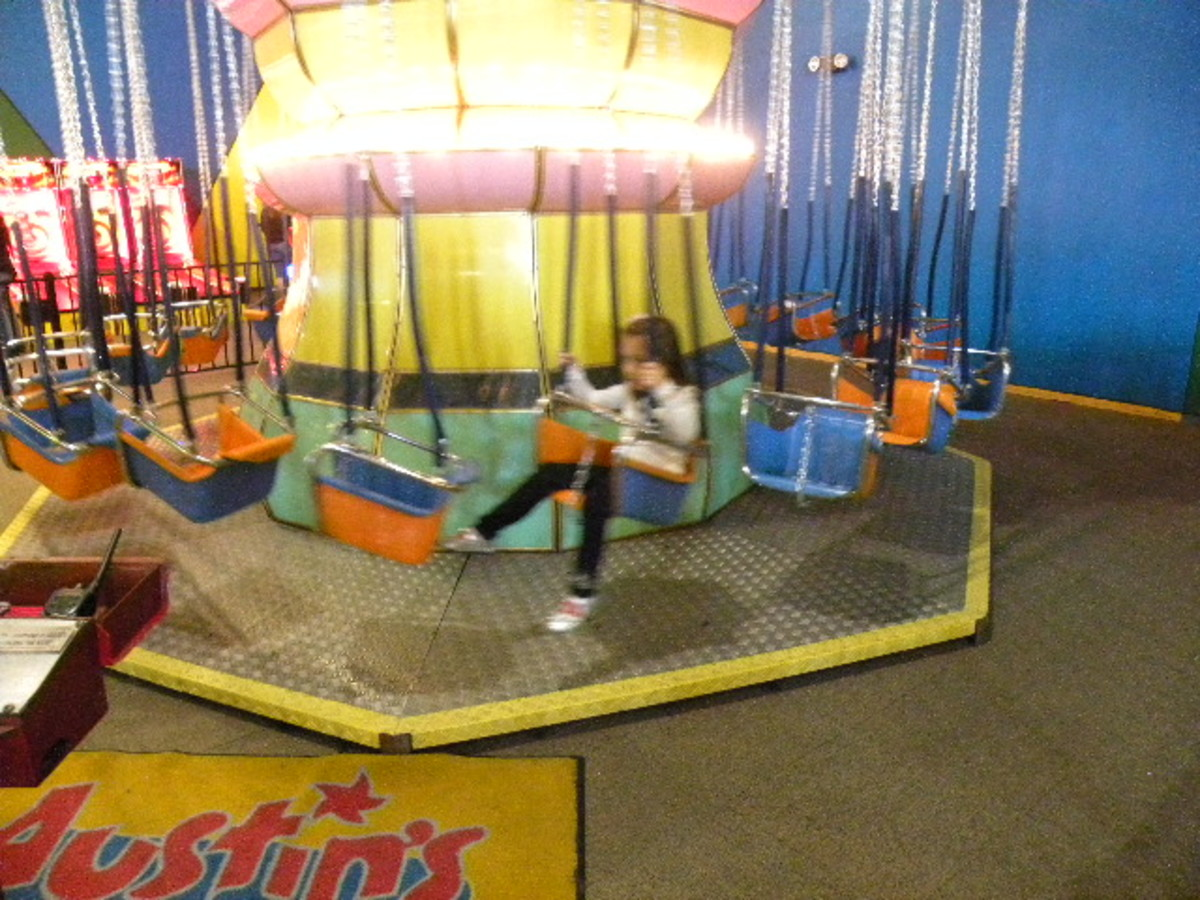 Swing Ride in the game room  Austin's Park and Pizza Pflugerville TX