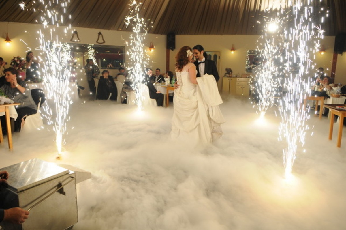 The Bride and Groom dance.