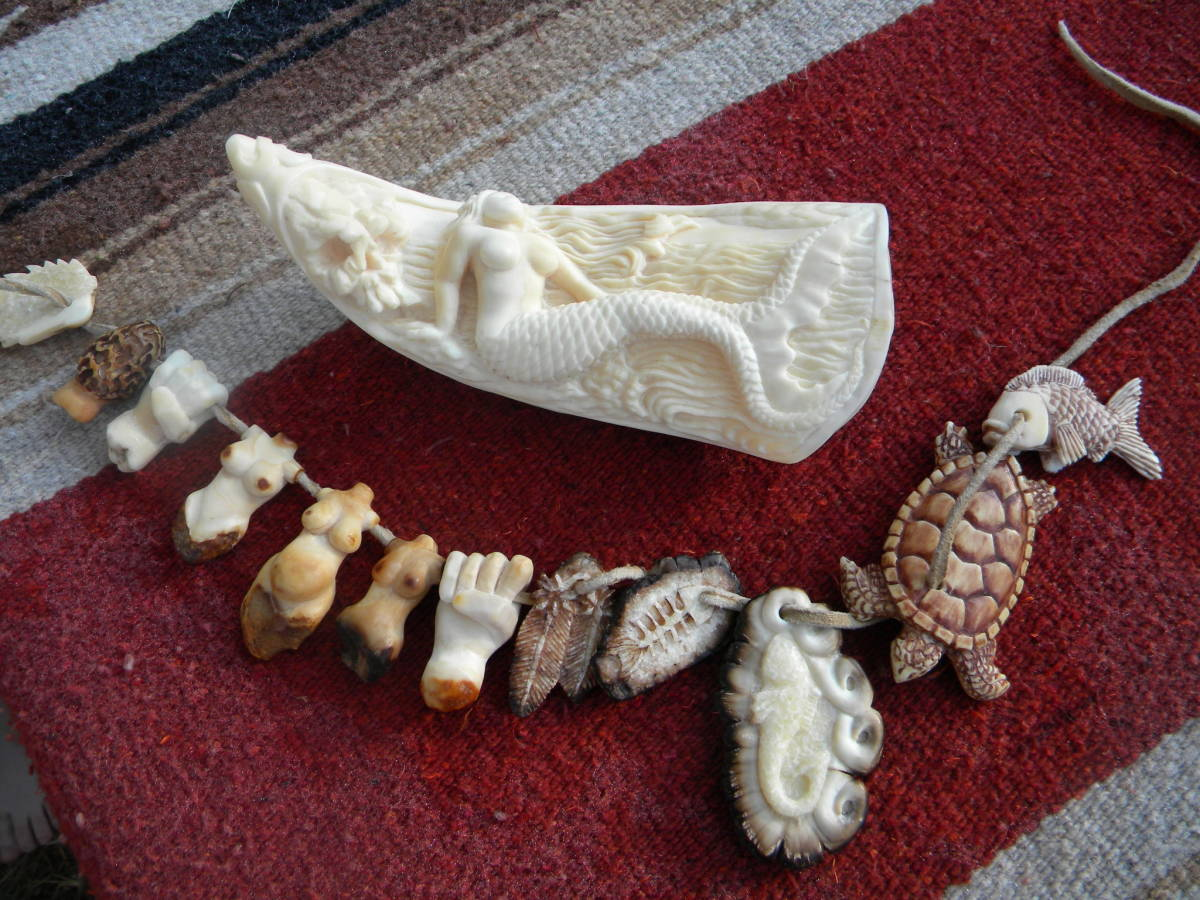 Miniature ivory carvings compared to the whale tooth - by Artist Wolf Harvey