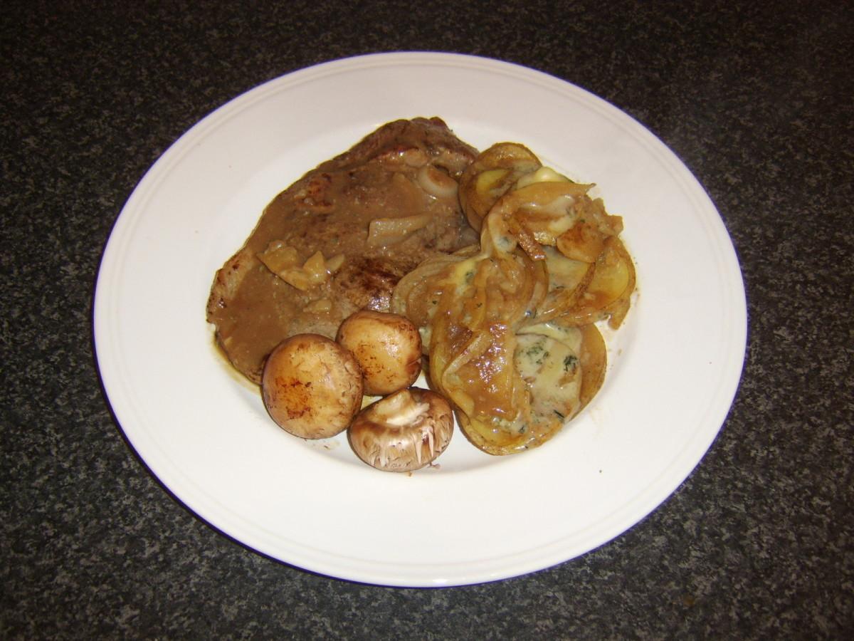 Sirloin steak with Stilton scalloped potatoes and fried chestnut mushrooms
