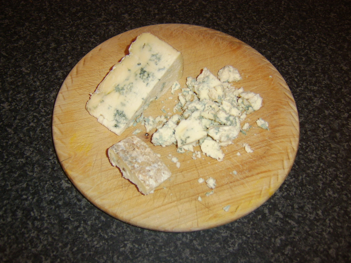 Stilton cheese is crumbled by hand