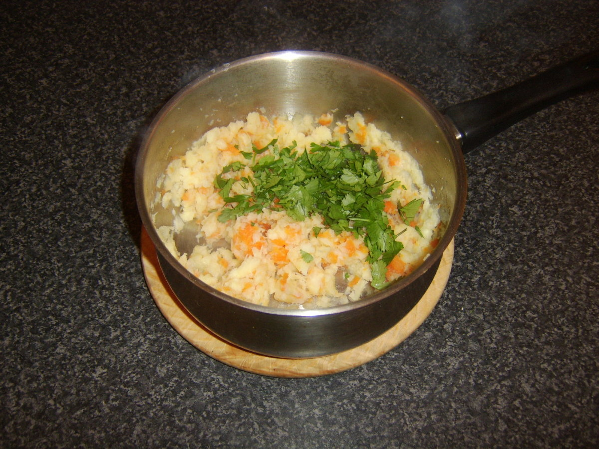 Coriander/cilantro is added to the carrot and parsnip mash