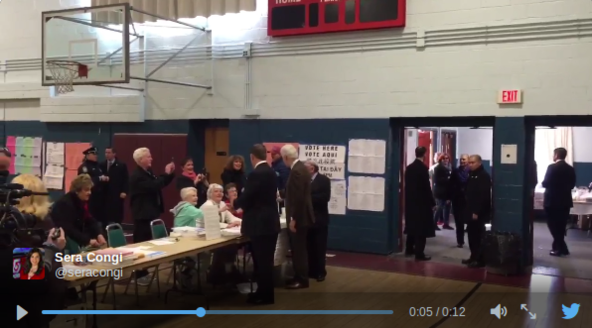 Clinton inside West Roxbury polling place.