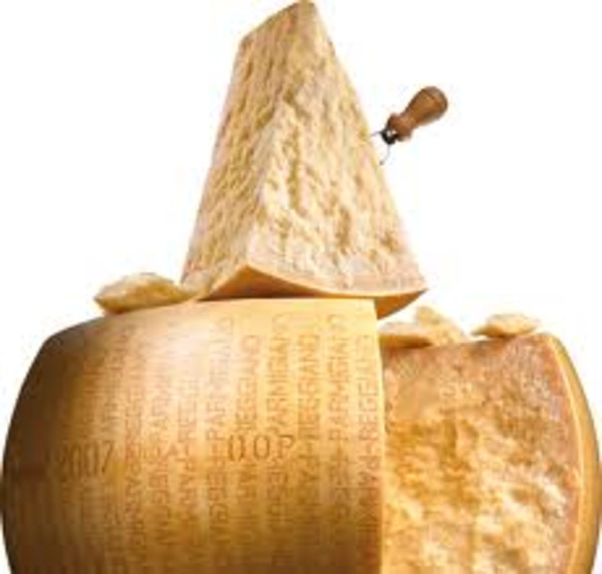 One cheese wheel of Parmigiano Reggiano that has been cut to use, just look at the texture you almost can taste it, yum!