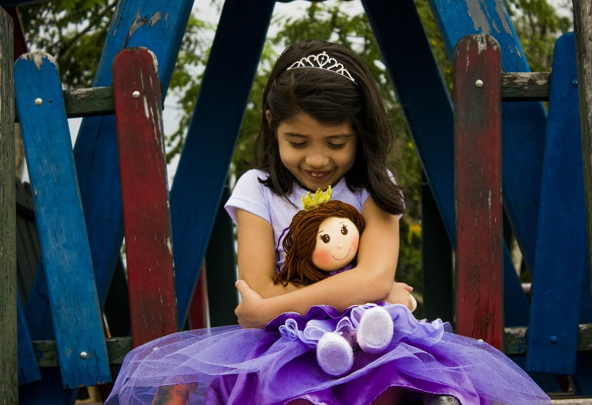 Every little girl loves her doll regardless of its type.