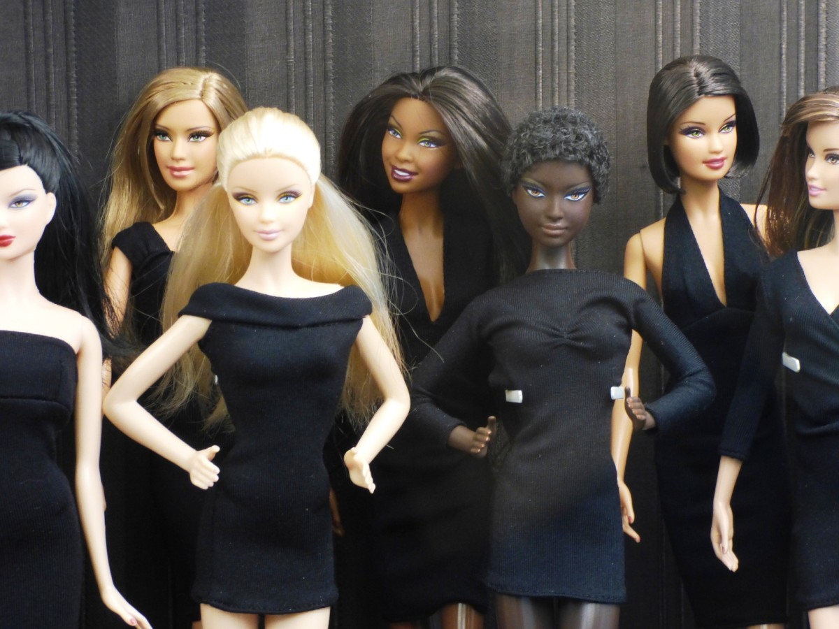 Dolls dressed in variations of the little basic black dress.