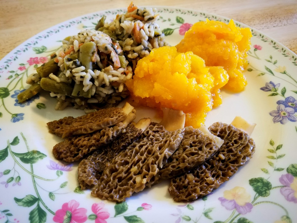 Halved Morel mushrooms, fried in salted butter and garlic, served with Hubbard squash and veggie rice.