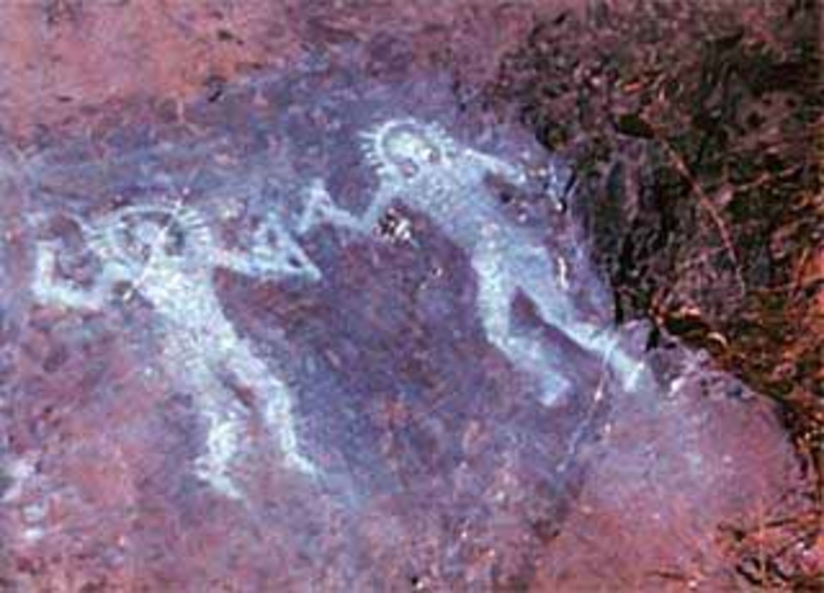 """Petroglyphs called """"astronauts"""" recently white coloured (probably plaster). Zurla Area, R 1, Rock Art Natural Reserve of Ceto, Cimbergo and Paspardo. Nadro, Rock Drawings in Valle Camonica. public domain"""