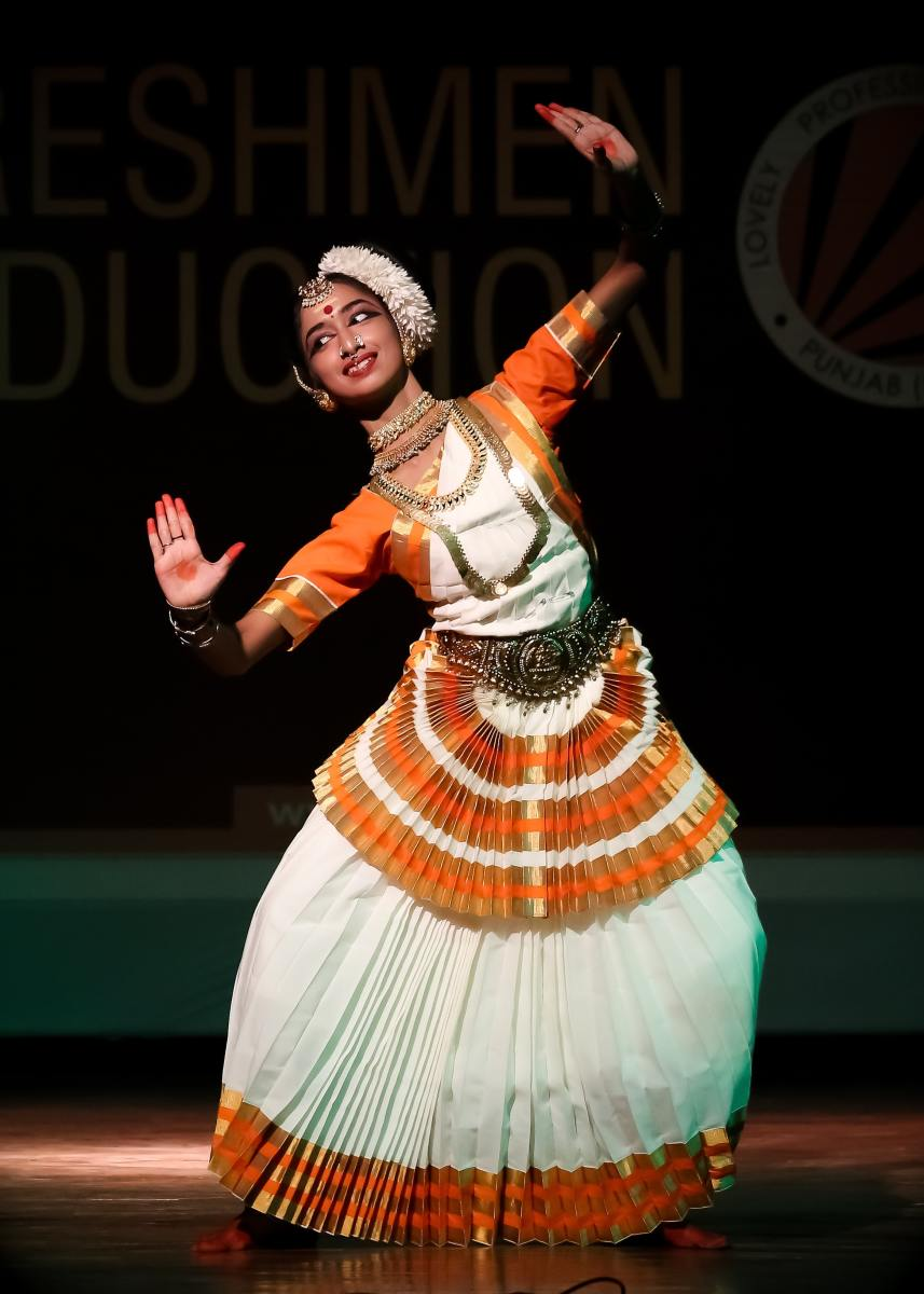 An Indian dancer wearing a traditional costume.