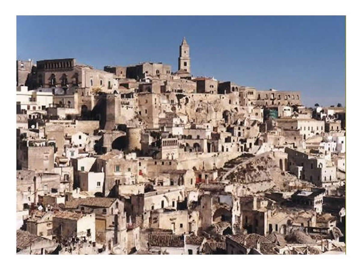 This photo of Matera town, shows us how they used to built then, they tried to build everything close together, so that they would be able to defend themselves if they were attacked from the enemy.