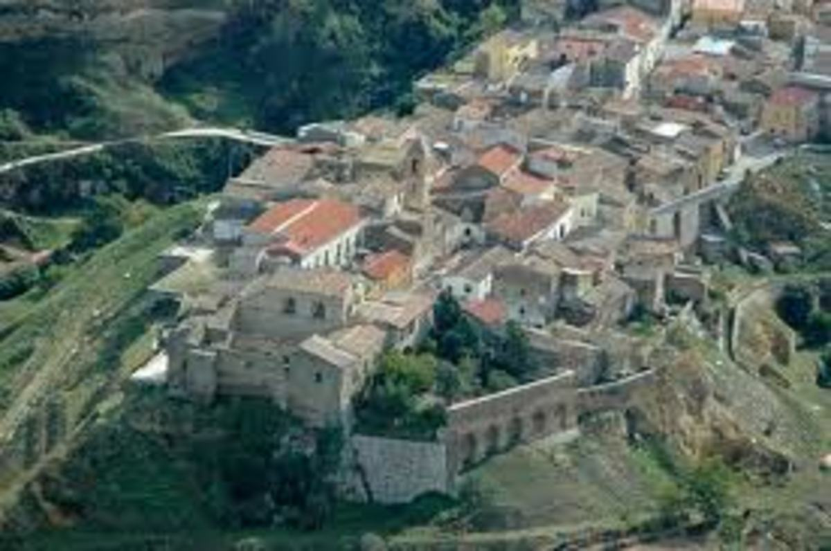 This is the very old Genzano town perched on a small high piece of land between two chasms. At the front of the picture is the old Monastery Annunziata and its garden beside it.