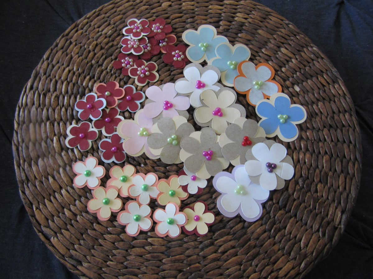 Punch your paper scraps and make flowers easily ! Just glue layers of punches. Add a sequin and a half bead