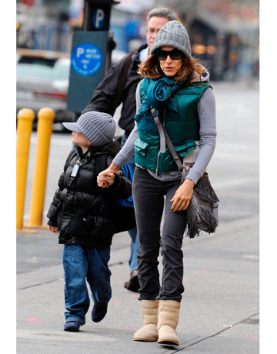 Sarah Jessica Parker sports lots of layers to keep the cold out! The green jacket and matching scarf gives her simple outfit a huge boost.