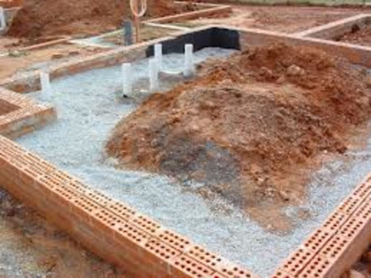 This is a low-set house on concrete floor, the drainage has been done, next it will be back-filled and the soil compacted 50 mm below the concrete floor, then there will be 50 mm of coarse river sand followed by damp course, steel mash and concrete.
