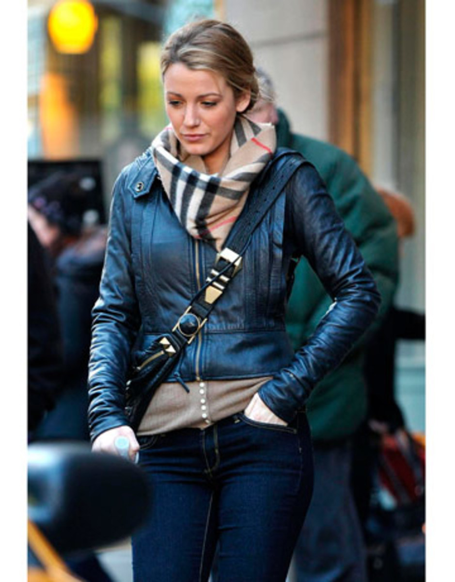 Blake Lively looks sleek in a motorcycle jacket layered with a Burberry scarf.