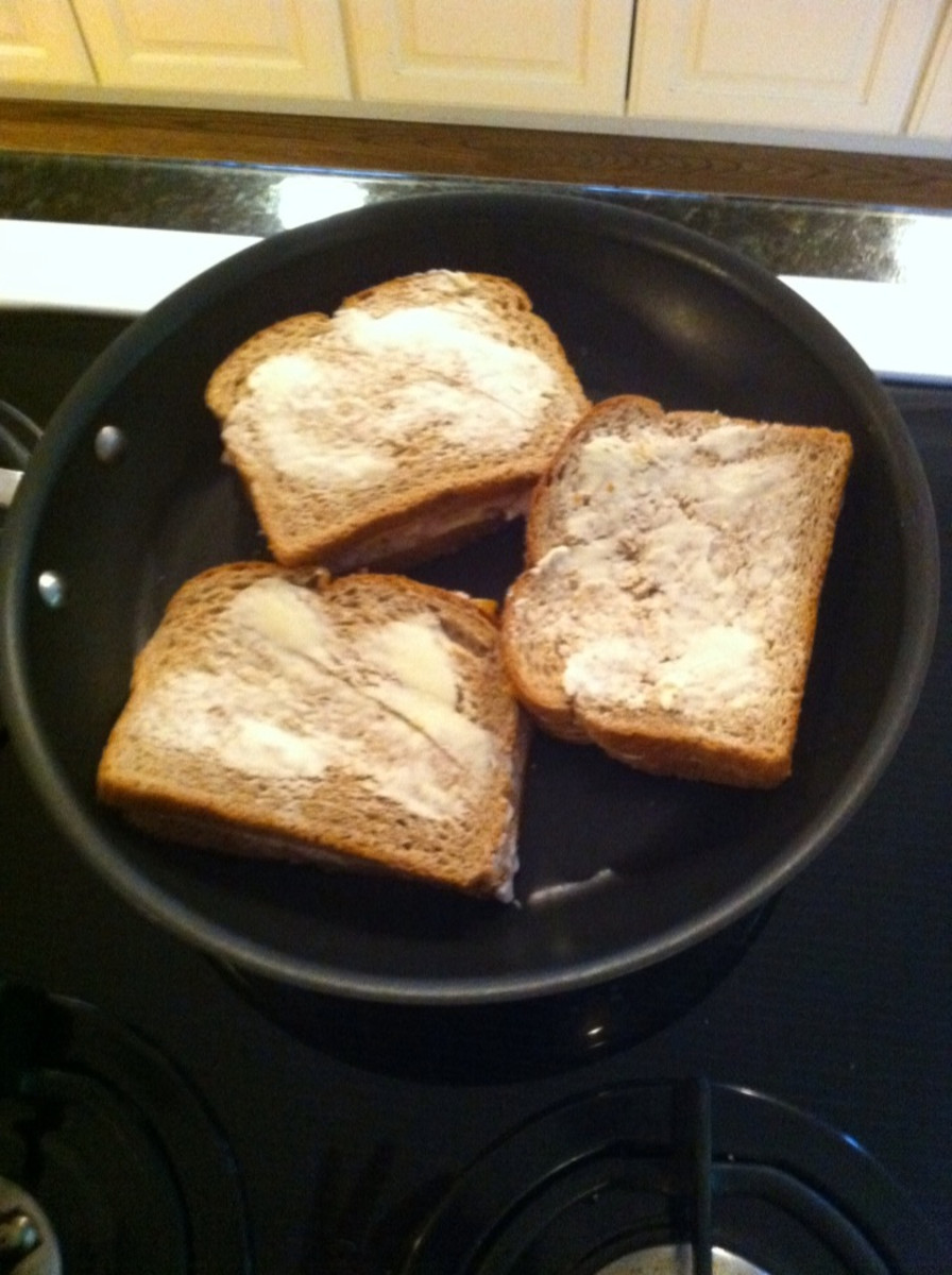 Put the sandwich on the side of the pan to keep it from cooking too quickly