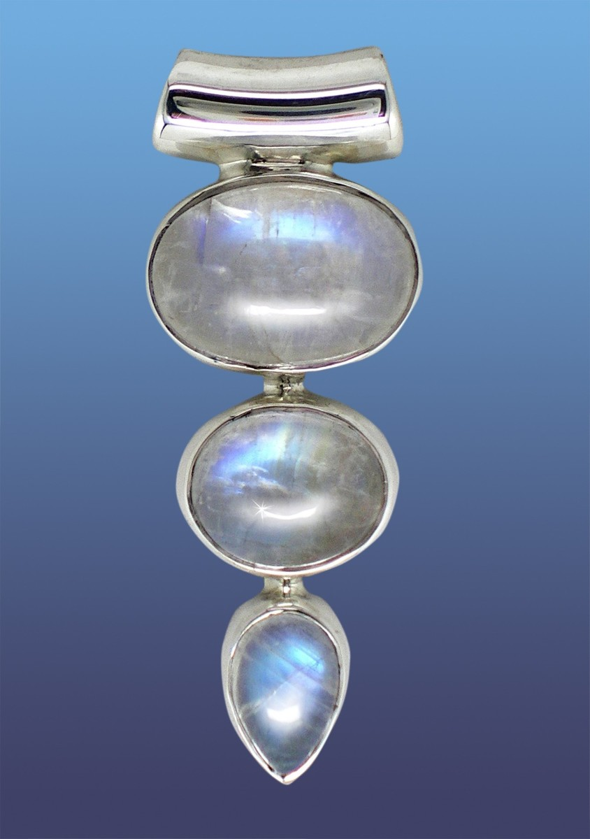 Custom-cut moonstones in a silver mounting.