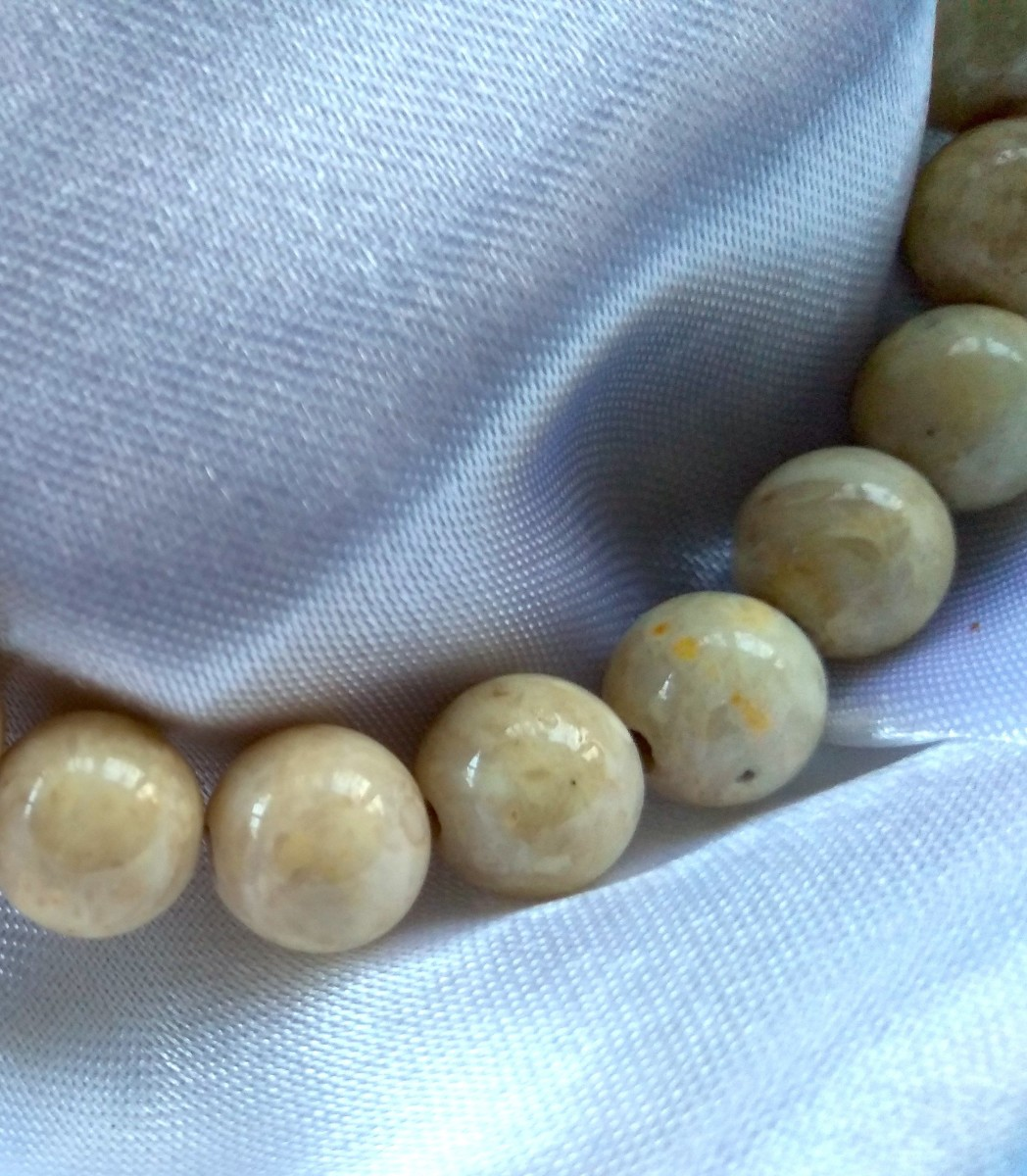 Riverstone, in polished beads. Excellent for self-care and prayer.