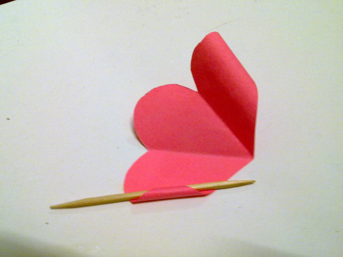Use a toothpick to curl inwards the left side of petal