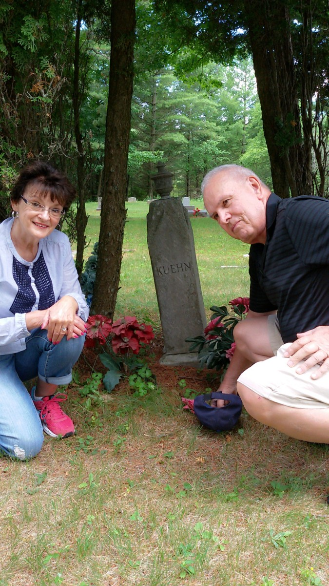 Grave our great-grandfather, Carl August Kuehn.  Author is pictured with his second-cousin Margie Kuehn Nelson.