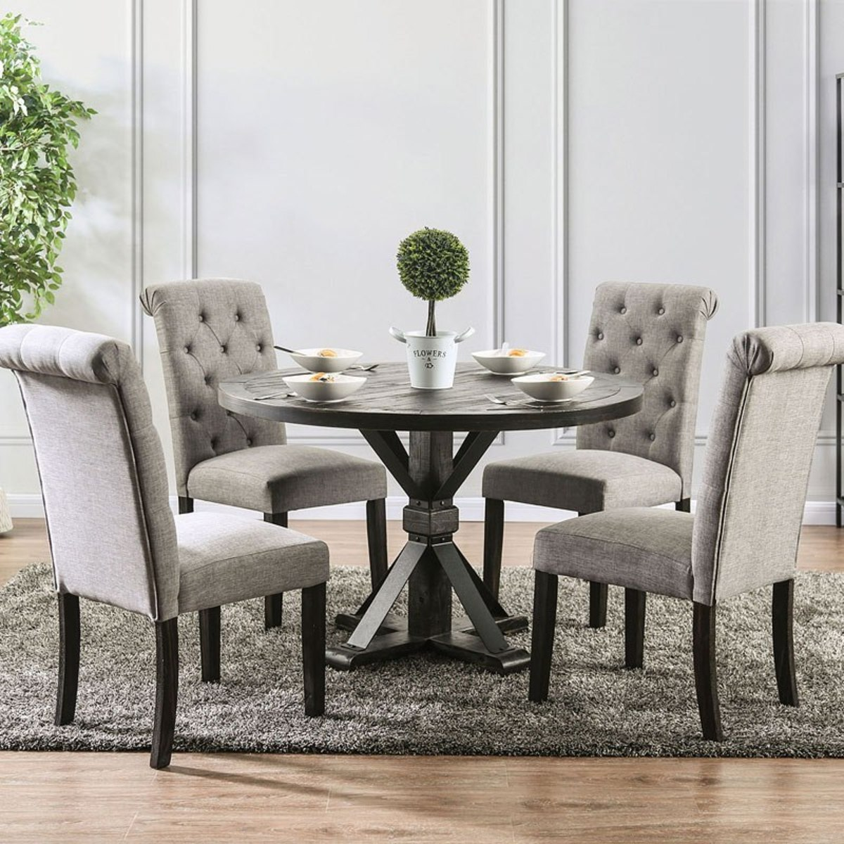 Featuring a wood table top, pedestal base, and metal accents, the table has a timeless look you will enjoy for years to come.