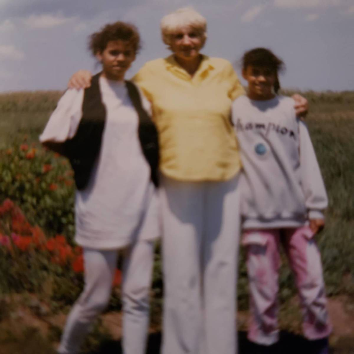 Mom between Terry on the left and Mary on the right.  Taken on Patty's farm in the late 1980s