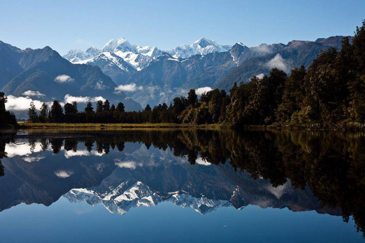 Mount Aoraki (Mt. Cook) & Mount Tasman reflecting over Lake Matheson (New Zealand)
